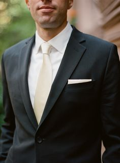 Modern Black and White Wedding: pocket square for the groom's tux (no boutonniere) - simple and masculine.