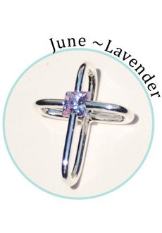 "Compelling Creations, Inc. - This beautiful cross holds a genuine crystal at its center.   Lavender is the birthstone crystal for June.    Celebrate a baptism, birthday, confirmation, first communion, or buy your favorite colors to match different outfits. 3/4"" long.       Available in the  Share It! rhodium plated line."