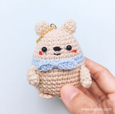 PATTERN A BEAR BALL.Materials : 1. Cotton yarn 4 ply in brown (for body), blue(for scarf) 2. 2.5 mm. crochet hook. 3. 2 black beads (6 mm in diameter). 4. Embroidery yarns. 5. Fiberfill stuffing. 6. Copper hook keychain. Abbreviations : single...