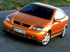 Opel Astra Coupé Bertone: my last car. Loved it. Unfortunately, one day it got crashed.