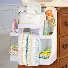 Nursery Organizer from OneStepAhead!  This space-saving nursery organizer does more than bring order to your changing table, it makes most of unused vertical space! You can hang it almost anywhere: from furniture rails, dressers and changing tables, wall hooks, you name it!