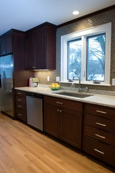 cabinet contrast with light oak floors and light granite