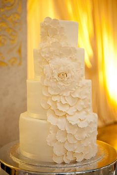 White wedding cake with white petal detailing  #White wedding receptions ... Wedding ideas for brides, grooms, parents & planners ... https://itunes.apple.com/us/app/the-gold-wedding-planner/id498112599?ls=1=8 … plus how to organise an entire wedding, without overspending ♥ The Gold Wedding Planner iPhone App ♥