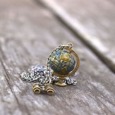 Travelers, explorers, curious observers of culture and nature alike... we have a necklace for you! This delightful miniature globe spins freely on the mount. It makes the perfect pairing with a binocu