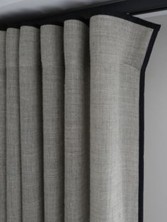 Simple and smart grey curtain with a contemporary wave heading. Thin black contrast banding adds a touch of bespoke luxury.