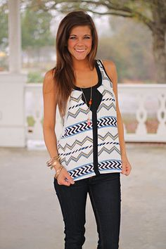 """This stylish tank is a must-have! The print is so chic and would look perfect with a pair of skinnies! Fits true to size. Miranda is wearing the small. From the shoulder to the hem: S-24"""" M-24.5"""" L-25"""""""