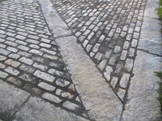 The combination of curbstone and Big Dig cobblestones make for an elegant motor court