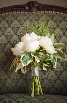 White Peonies And Vertigated Hosta Leaves