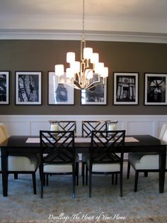 wainscotting and row of pix...like this idea for a dining room