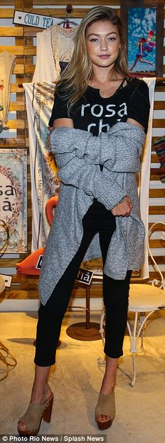Casual: Gigi was spotted in a more relaxed ensemble as she promoted the collection earlier...