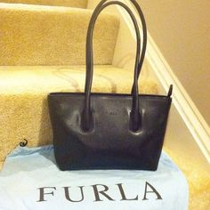 Authentic Furla Purse Authentic genuine leather Furla handbag. Purchased at Furla boutique in Italy. Some scratches on the leather--see pictures. Interior is in pristine condition. Comes with original dustbag. Furla Bags Shoulder Bags
