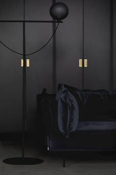 The iconic Studio Lamp series, designed by Laura Bilde, and the Globe Light series, designed by Emil Thorup, are part of the permanent lighting. Studio Lamp, Black Floor Lamp, Black Cabinets, Globe Lights, Danish Design, Simple Designs, Scandinavian, Furniture Design, Table Lamp