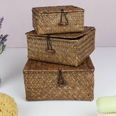 Offering fantastic useful storage for any room in the home.Made from intricately hand woven wheatgrass, these thoughfully sized stacking baskets are complete with lids to keep clutter neatly tidied away. Complete with wooden toggle fastenings they are suitable for a multitude of uses around the home, from storing receipts and bills in the hallway, to storing face cloths and lotions and potions in the bathroom. The natural finish enures they compliment existing decor.Natural Wheat…