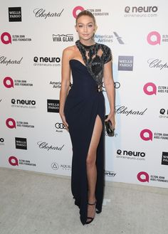Ever the stunner, Gigi Hadid showed some leg in a slit navy gown at the Elton John Oscars party.