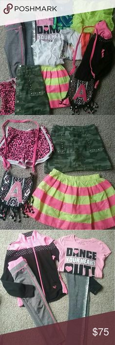 JUSTICE bundle deal Justice bundle deal  Girls clothing lot  Sizes 8 and 10 All excellent condition. Like new 2 skirts, 1 shorts, 2 sweat/jogger pants 1 zip up jacket 1 pocket book 2 boho tops 1 tank 1 t shirt 1 dress/cover up Justice Shirts & Tops