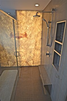 AFTER - Backlit onyx shower wall