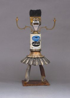 SUE is a one-of-kind metal art robot. This whimsical metal art sculpture is created from found objects which include a tin can, candle part,