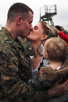 Marine Corps Pfc. Clayton greets his family during a homecoming ceremony on Marine Corps Air Station New River, N.C., Dec. 17, 2012. Smith is assigned to Marine Medium Tiltrotor Squadron 261 (Reinforced), 24th Marine Expeditionary Unit. The 24th MEU returned to the U.S. after completing a nearly nine month deployment as an expeditionary crisis response force with the Iwo Jima Amphibious Ready Group. U.S. Marine Corps photo by Staff Sgt. Robert L. Fisher