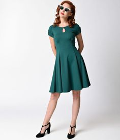 It's all in the name, dames! The Charm Me Keyhole Dress from Steady is the perfect little retro number for cocktail season and beyond! This vintage infused flare is cast in sturdy stretch knit with teardrop cutout short sleeves, a teardrop center cutout a