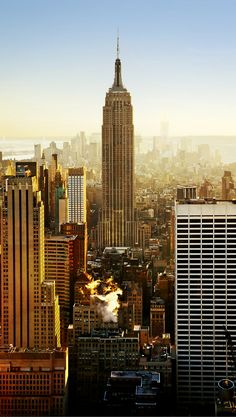 """View of the the empire state building! New York City is a city that is so iconic, you really don't have to introduce it. It is affectionately called """"The Big Apple"""", is the largest city in the USA, and is one of the world's financial and cultural centers. Have you been to the 10 most iconic places in NYC?"""