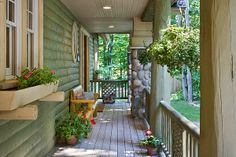 Front porch on the hybrid log and craftsman style home