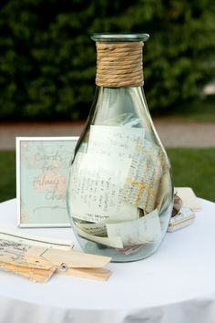Alternative Guest Book Idea: Guests write notes and put them in a bottle. The bottle makes a nice and meaningful piece in your home, or you can even make them into a scrapbook later!