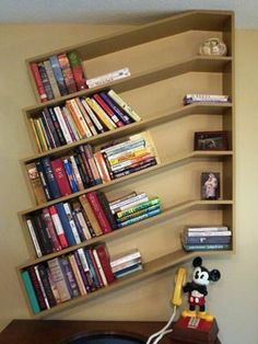 Slanted Bookshelves. These unique slanted bookshelves add visual interest to any room. They're unique yet functional - and the best part? Your books won't tip over on these bookshelves.
