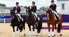 Team Dressage Gold: Carl Hester on Uthopia, Charlotte Dujardin on Valegro and Laura Bechtolsheimer on Mistral Hojris celebrate with their gold medals -Day 11