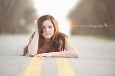 I love that she is laying in the middle of the road! Liz Labianca Photography