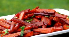 """POMEGRANATE BALSAMIC GLAZED CARROTS    1/4 cup pure pomegranate juice   1 Tablespoon balsamic vinegar   2 teaspoons honey   2 Tablespoons butter, divided   2 Tablespoons extra-virgin olive oil   2 pounds carrots, trimmed, peeled and cut into sticks about 2"""" long and 3/8"""" wide   Kosher salt   1/3 cup chicken broth   1/8 teaspoon cayenne   2 Tablespoons lightly packed thinly sliced mint"""
