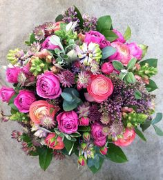 pink spring bouquet with ranoncula and lilac