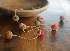 Felted Wool Acorn Garland in Fall Colors on Hemp Twine. This is fall needle felted wool acorn garland made by me. The garland is 4 feet long and has 10 felted wool acorns in ten fall colors that have been strung on hemp twine as shown. The acorns are approx 1-1.5 inches long. The Red Oak Acorn Caps were found in the forest near my Pennsylvania home. The garland makes a great fall or holiday decoration for your home. If you prefer a different length, just contact me and I can make a custom...