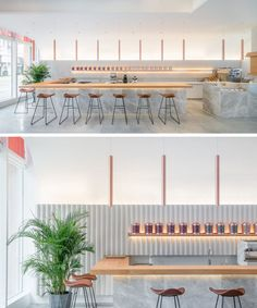In this modern tea house, a long timber counter runs along one side of the interior, and serves Chinese tea in the daytime and cocktails at night. The half-vaulted ceiling is adorned with copper pendant lights to create a cozy atmosphere. #Bar #WoodBar #ModernRestaurant #ModernTeaHouse #InteriorDesign