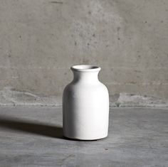 Tine K Home Ceramic White Vase: These gorgeous little Bottle Vases are hand glazed with a White finish. Designed by Tine K Home in Denmark, they make a beautiful gift or display piece.