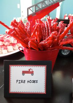 "Great idea for firemen bachelor party.. ..to start with.. ...firetruck party food ideas ""fire hoses"" using licorce."