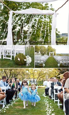 wedding ceremony - white draping with white garland, colorful flowers at base of structure