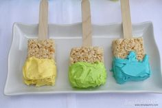 Rice Krispie squares paint brushes with icing paint in different colors.