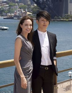 Firm friends: The director with the actor Miyavi at a photocall for Unbroken in Sydney...