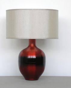 """Babette Holland's handspun aluminum table lamps show her new Raku Red Horizon finishes. She calls the hand-tinted finishes """"an homage to Mark Rothko."""" The Rubianne lamp base is 18.5 inches..."""