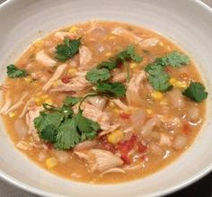 "Slow-Cooker White Chicken Chili: ""An amazing recipe. I don't know what makes it so good, but yum! We keep the makings for this recipe in our house at all times for cold, snowy days — it's our go-to co (Chicken Chili Sides)"