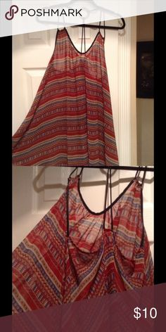 Semi sheer flowy racer back boho print  top NWOT Brand new tags removed never used. Double narrow strap racer back flowing flare long top. Straps in back are embellished with wood disk. Boho design semi sheer flowy fabric. Looks great with a sports active crop top underneath. Colors of black burgundy gold . Very stylish. Tops