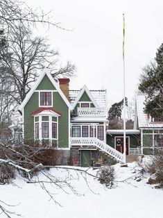 A GREEN WOODEN HOUSE IN SWEDEN