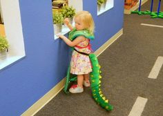 Since she was already wearing a dino tail, she had to wear the mermaid tail around her neck!