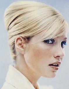 sleek French twist.  draws all of the attention to the face!