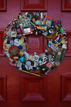 Nostalgia wreath... such a cool idea you could adapt with a multitude of themes. Love this and could do it with all the kiddos little junk toys