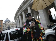 Retired NBA star Dennis Rodman visits the Vatican during the papal conclave, declaring his support for an African pope. 13 March 2013