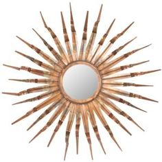Wrought iron wall mirror with a textured sunburst frame. Product: Wall mirror Construction Material: Iron and mirrored glass Color: Copper, gold and bronze Features: Offers dimensional design Warm, welcoming feel Dimensions: Diameter
