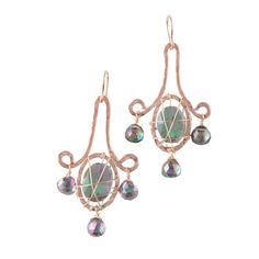 Edina Kiss Mystic Sapphire Chandelier Earrings    Sapphires are known to have protective properties. Make a bold statement with these handmade Mystic Sapphire and 20K Rose Gold Earrings. Each piece of Edina Kiss Jewelry is handmade.    Price: $248.00