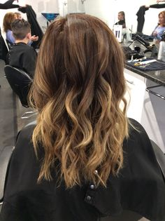 Brown base melt with caramel blonde ends. Caramel blonde ombré balayage