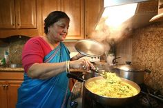 A mother cooking food, a traditional thing that occurs in India. I chose this picture its shows the mother making food for her family. (Who makes the meals)